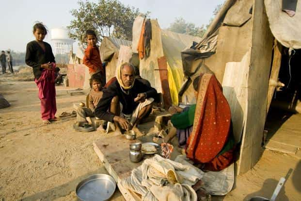 A combination of high growth and social security programmes by both central and state governments led to poverty coming down from 41.6% of the population in 2005 to 23.6% in 2012. Photo: Ramesh Pathania/Mint