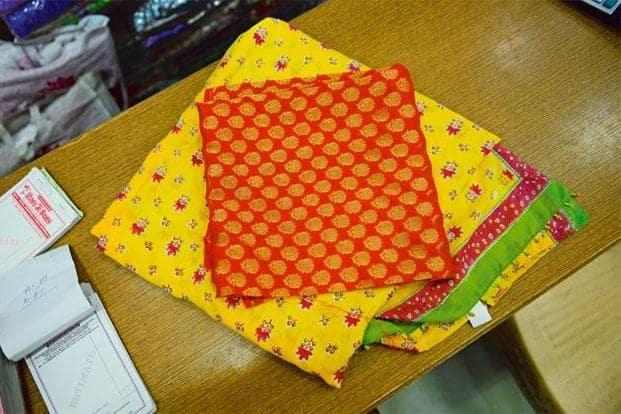 Orange and gold brocade material with small 'bootis', Rs375 per metre, Rama Apparels, 2-D-8B, Central Market, Lajpat Nagar II, New Delhi (9810156657).