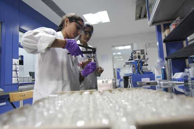 A file photo of scientists working on malaria medicines. When compared with traditional diagnostic methods, the new handheld device would collect a significantly low amount of blood, about 200 nanolitres. Photo: HT