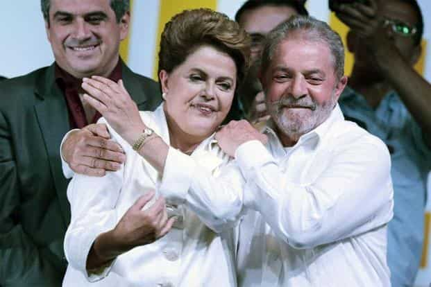 Former president Luiz Inacio Lula da Silva congratulates Dilma Rousseff after announcement of the election results, in Brasilia. Dilma, now 66, first came to prominence as the protege of Lula da Silva, when he was the president. Reuters