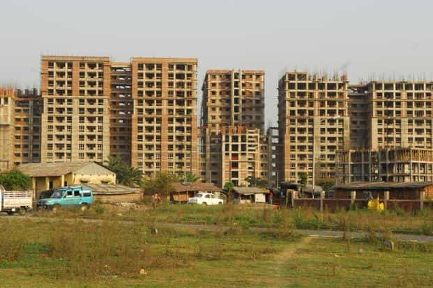 The construction of a residential complex in Rajarhat, Kolkata. After the latest amendment, the ceiling on private ownership of land at 24 acres has been removed. Photo: Indranil Bhoumik/Mint