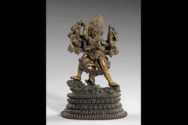Hevajra: Kapaladhara Hevajra in his sixteen-armed form, with eight heads, stands in pratyalidhasana on four Maras whose bodies are intertwined. He is joined in yab-yum with his consort Nairatmya.