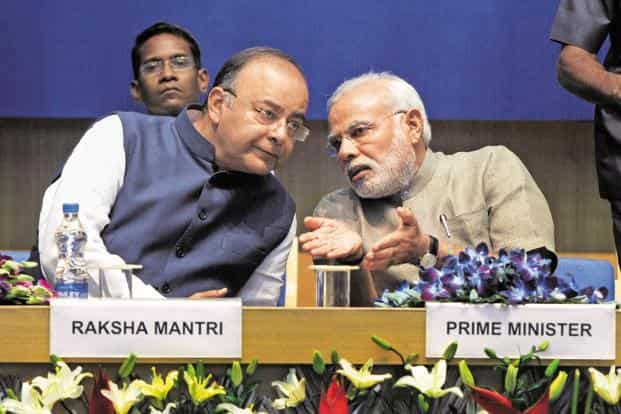 A file photo of Prime Minister Narendra Modi (right) and finance minister Arun Jaitley. Jaitley had told parliament that the 'smart' cities are needed to accommodate the rising numbers. Photo: HT