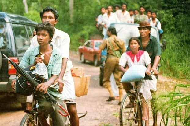 Villagers fleeing Kotiyagala during a heightened period of the civil war in Sri Lanka. Photo: Sena Vidanagam/AFP