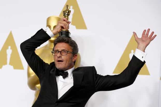 Poland's 'Ida' won Best Foreign Language Film, the first film from Poland to ever win the Oscar in the category. Pawel Pawlikowski, the film's director poses with the award. AP