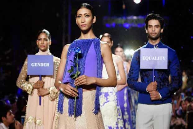 Manish Malhotra combined glamour with social messages as his models highlighted gender issues at the fashion week. PTI