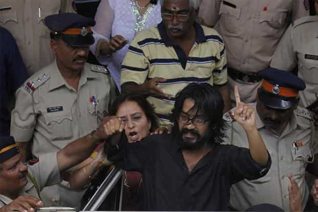 Cartoonist Aseem Trivedi was charged with sedition for displaying cartoons mocking Parliament and corruption in September 2012. Photo: Hindustan Times