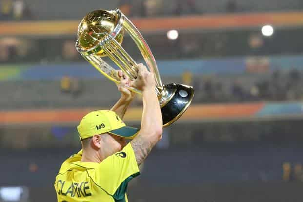 Australia captain Michael Clarke lifts the World Cup trophy after winning over New Zealand by seven wickets in Melbourne on Sumday. Photo: Rick Rycroft/AP