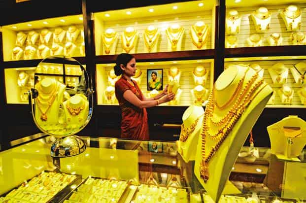 Gold in Singapore, which normally sets price trend on the domestic front, traded a shade lower at $1,213.21 an ounce. Photo: Priyanka Parashar/Mint