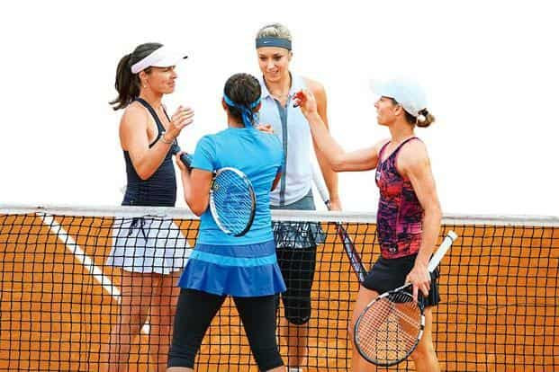 Double duel: (clockwise from left) Martina Hingis, Sabine Lisicki, Cara Black and Sania Mirza during a match at the Internazionali BNL d'Italia on 13 May in Rome, Italy. Photo: Julian Finney/Getty Images