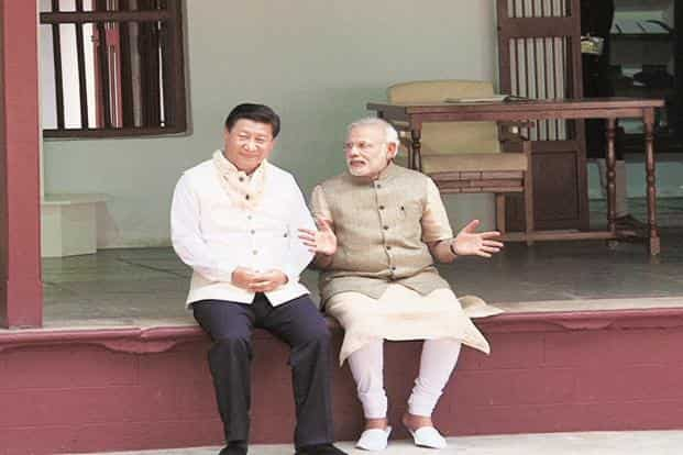 A file photo of China's President Xi Jinping and PM Narendra Modi at the Sabarmati Ashram, Ahmedabad. Modi will start his China visit on 14 May. Photo: AFP
