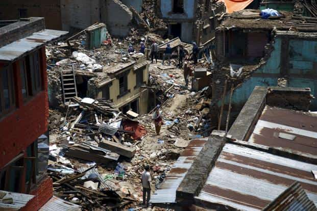 People walk along the debris of the collapsed houses after a fresh 7.3-magnitude earthquake struck Nepal on 12 May 2015. Photo: Reuters