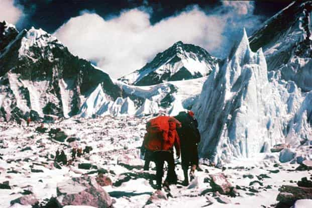 The 1965 expedition makes its way trough the Khumbu Icefall. Photo: Courtesy Mercury Himalayan Expeditions.