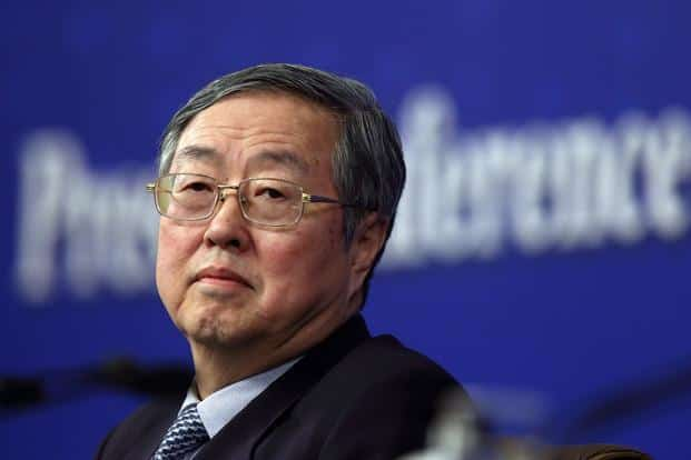 Central bank governor Zhou Xiaochuan has accelerated monetary easing just as local authorities kick off more than 1.77 trillion yuan ($286 billion) of bond issuances, a four-fold jump from 2014. Photo: Bloomberg