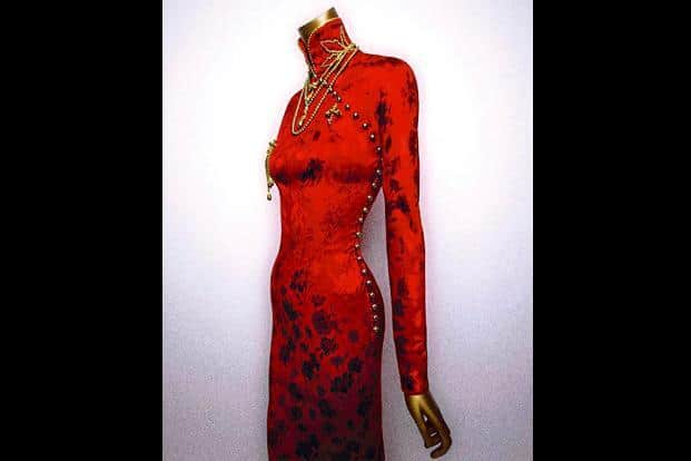 633c897d8 ... John Galliano's creation in red silk, at the museum in New York. Photo  courtesy