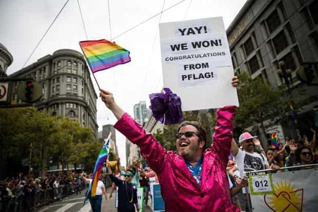 Brandon Brock of PFLAG marches in the San Francisco Gay Pride Parade, 28 June, 2015 in San Francisco, California. The 2015 pride parade comes two days after the US Supreme Court's landmark decision to legalize same-sex marriage in all 50 states. Photo: Max Whittaker/Getty Images/