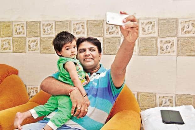 Sunil Jaglan with his daughter. Photo: Pradeep Gaur/Mint