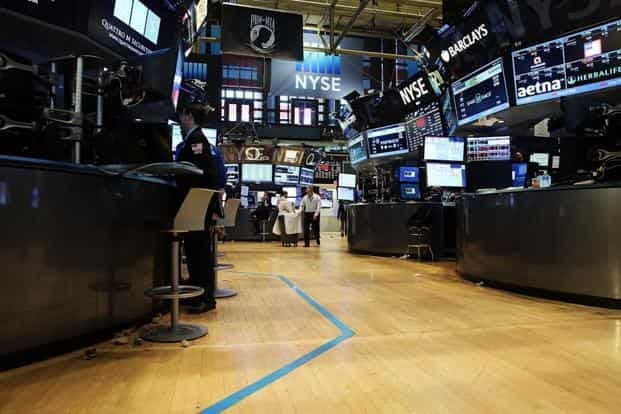A nearly empty trading floor at the NYSE after trading was halted. The breakdown is the most serious outage since the Nasdaq Stock Market halted trading in its shares in August 2013 due to a broken price feed. AFP