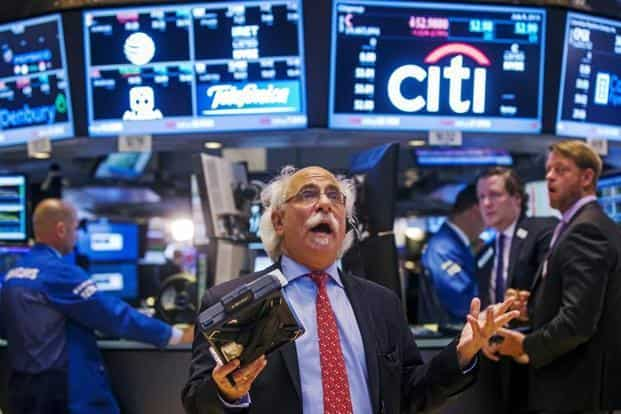 Trader Peter Tuchman gestures as he talks on the phone even as trading was stopped for several hours on the floor of the New York Stock Exchange in New York, on 8 July, 2015. Reuters