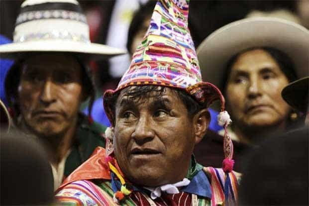Bolivian natives listen to Pope Francis. Pope Francis, history's first Latin American pope apologized for the sins of the Catholic Church against indigenous peoples during America's colonial-era conquests. AFP