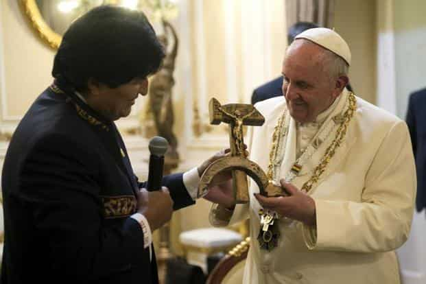 "Bolivian President Evo Morales handed Pope Francis a ""Communist crucifix""—a crucifix mounted on a carved wooden hammer and sickle on Thursday. Though Francis was surprised by the gesture, Bolivia said it was not a political move. Reuters"