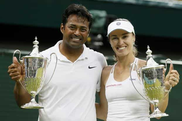 Leander Paes and Martina Hingis show off their trophies after winning their mixed doubles final match at the Wimbledon Tennis Championships in London. Photo: Reuters