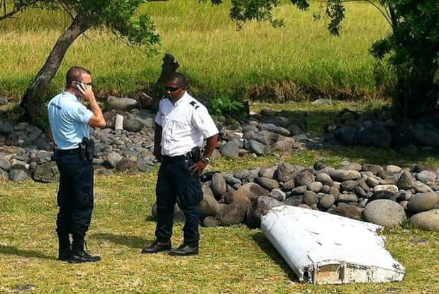 A piece of debris from an unidentified aircraft found in the coastal area of Saint-Andre de la Reunion, in the east of the French Indian Ocean island of La Reunion, on Thursday. Photo: AFP