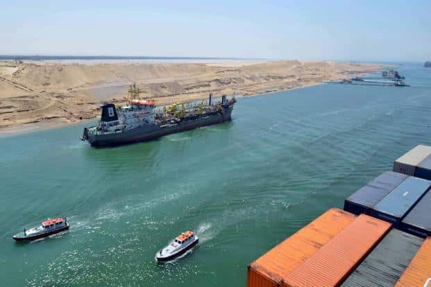 A cargo ship is seen crossing through the New Suez Canal, Egypt. Photo: Reuters