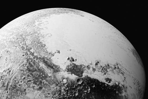 A synthetic perspective view of Pluto, based on the latest high-resolution images to be downlinked from Nasa's New Horizons spacecraft. Photo: Reuters/Nasa