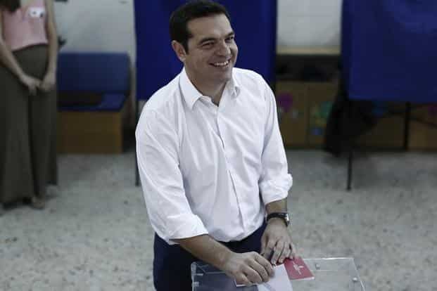 Alexis Tsipras, former Greek prime minister and leader of the Syriza party, reacts as he places his voting slip in a ballot box as he votes in the general election at a polling station in the suburb of Kypseli, Athens, Greece, on Sunday. Photo: Bloomberg