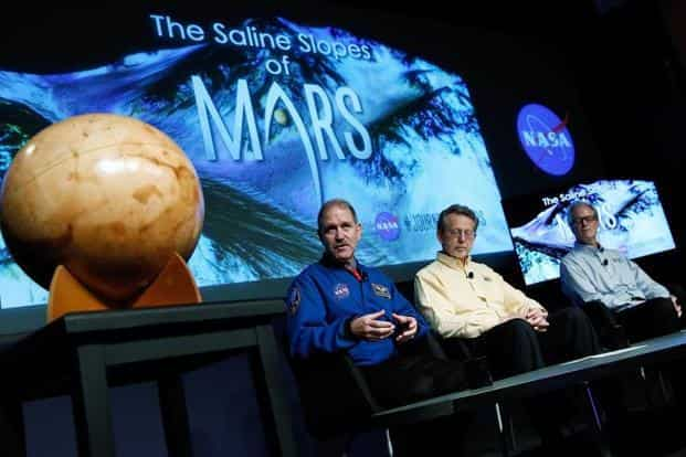 """""""Our quest on Mars has been to follow the water in our search for life in the universe, and now we have convincing science that validates what we've long suspected,"""" scientists say during a press conference where Nasa announced new findings that provide the """"strongest evidence yet"""" of salty liquid water currently existing on Mars. AFP"""