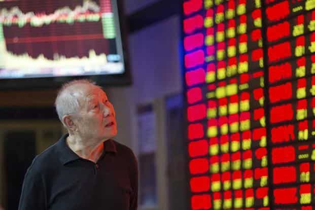 The Shanghai Composite Index fell 29% in the third quarter, the most worldwide, and the yuan weakened 2.4% after authorities devalued the currency in August. Photo: Reuters