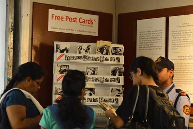 A DMRC guard says 1,500 postcards have been picked up by people in the three days of the exhibition.