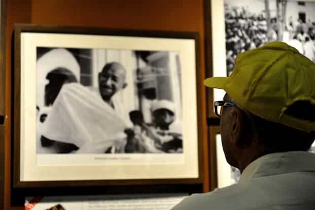 Candid photographs of Gandhi have many viewers.