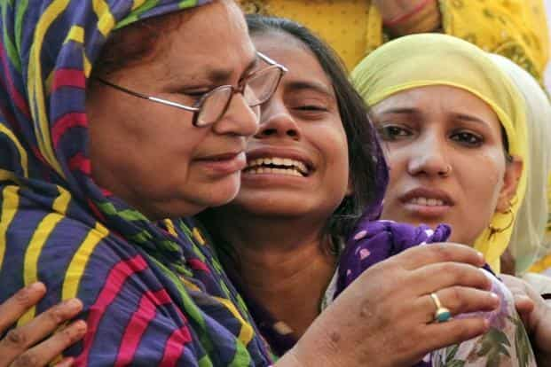 Relatives of Mohammad Ikhlaq mourn after he was killed by a mob at his residence in Dadri. Photo: Reuters