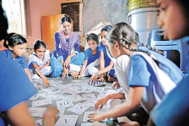 Padma Pawar, 21, who was married off when she was in Class VIII, now works as a volunteer for Educate Girls, an NGO, teaching children at the local school in her village in Rajasthan. Photo: Priyanka Parashar/Mint