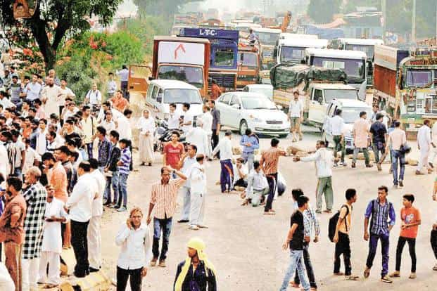 Protesters block a road in Faridabad after two Dalit children were burned alive in Sunped village on Tuesday. Photo: PTI