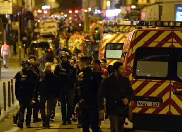 Police forces and rescuers near the Bataclan concert hall in central Paris, early on 14 November 2015.  Photo: AFP