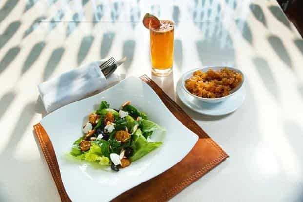 A salad, juice, and chutney with 'amla' as one of the ingredients.