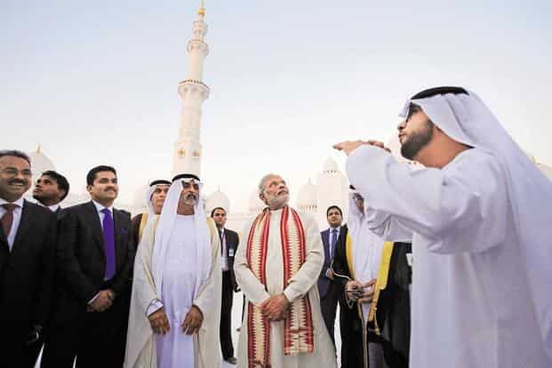 The PM listens to a guide as he visits the Sheikh Zayed Grand Mosque in Abu Dhabi, United Arab Emirates, in August. Photo: Kamran Jebreili/AP