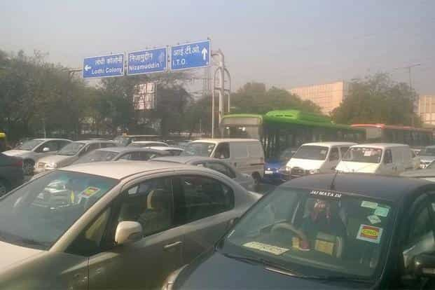 Cars with CNG stickers seen on the roads. The odd-even plan excludes CNG vehicles. Photo: Ramesh Pathania/Mint