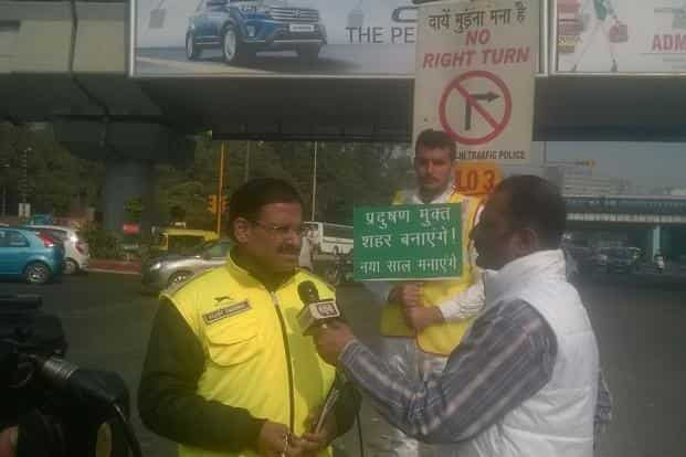 Media has keenly been tracking the response to the odd-even initiative. A TV crew speaking to civil defence volunteer Near ITO. Photo: Ramesh Pathania/Mint
