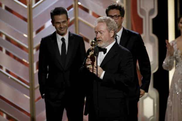 Ridley Scott accepts the award for best motion picture (comedy) for The Martian AP