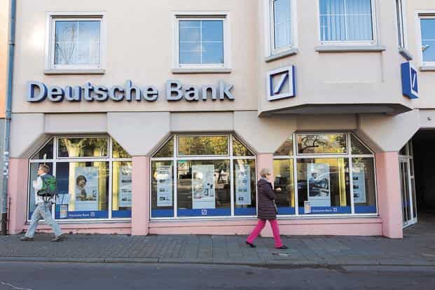 Former executives of Deutsche Bank, including Josef Ackermann (former chief executive officer), Juergen Fitschen (former co-chief executive) and Anshu Jain (also former co-chief executive) got the most negative coverage among top bankers. Photo: Bloomberg