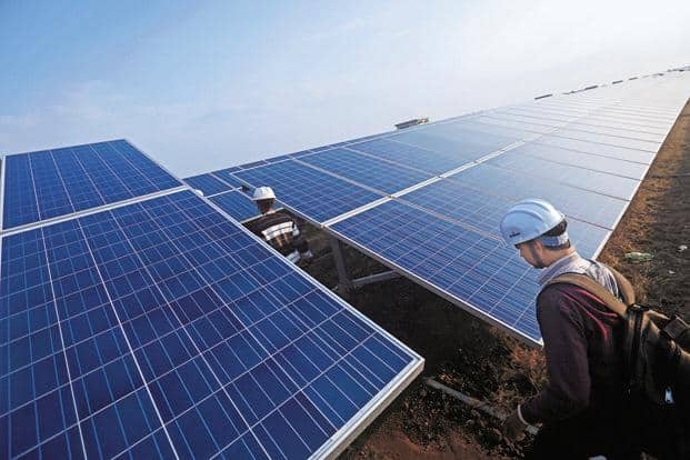 The tariff for solar power has fallen from `18 per unit a few years ago to an unprecedented level of below `5 per unit—a big step in promoting clean energy. Photo: Bloomberg