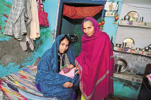 22-year-old Bubly (left) and her mother-in-law Krishna, with Bubly's two-month-old daughter at their house in Rohtak's Bhagwati Pur village. Bhagwati Pur's sex ratio at birth has fallen from 848.48 in 2014 to an alarming 549.02 by 2015 end, according to the state's health department's data. Photo: Priyanka Parashar/Mint
