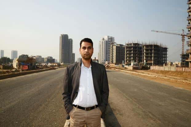 Gaurav Prakash had bought a house in 2011, but is still waiting for construction to finish. In the meanwhile he has to pay not only the loan instalments but also rent which increases his cost of acquisition. Photograph: Ramesh Pathania/Mint