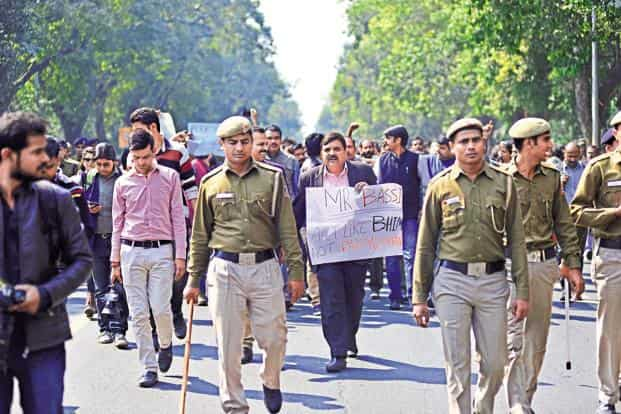 The protest march was stopped by police a kilometer away from the Supreme Court with only a small delegation allowed to submit a petition at the Registrar's office in the apex court. Photo: Pradeep Gaur/Mint