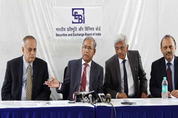 Sebi chairman U.K. Sinha with the board members after the Sebi board meeting in New Delhi. Sinha said Sebi takes pride in the fact that there have been no instance of any major market misconduct for over a decade. Photo: AP