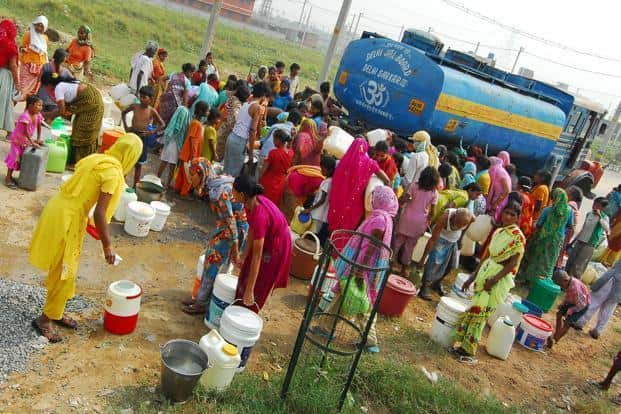 A file photo of people stocking at a water tanker in Delhi. The district collector has issued the direction as a preventive measure around the Latur civic body-run tanks. Photo: Mint